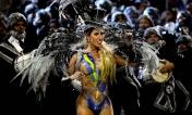 A dancer of the Gavioes da Fiel samba school performs in Sao Paulo. (Andre Penner/Associated Press)